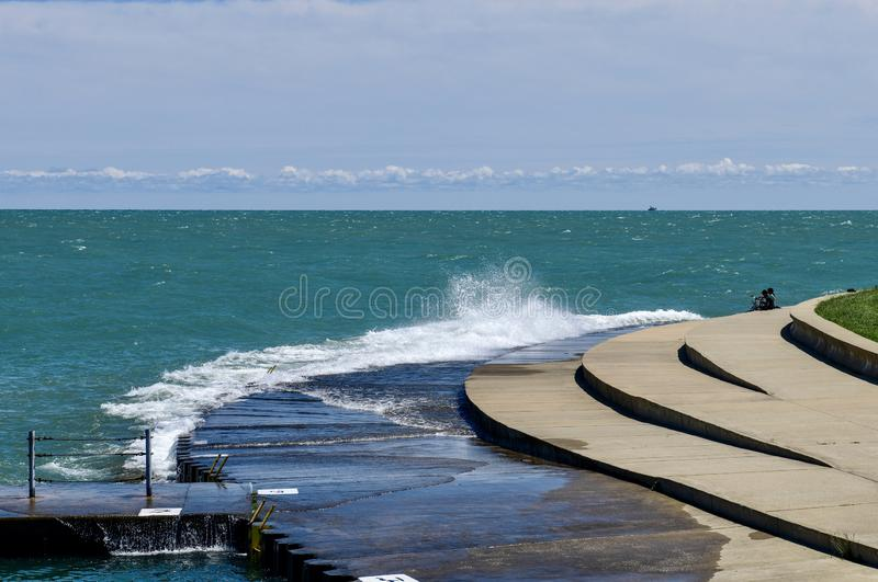 Waves Crashing on Diversey Harbor Outlet royalty free stock photo