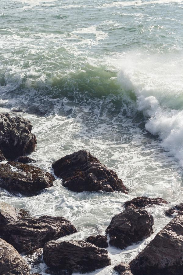 Waves crashing over rocks in NZ stock photos