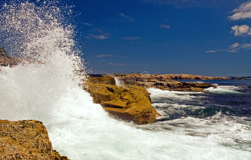 Waves crashing on rocks royalty free stock image