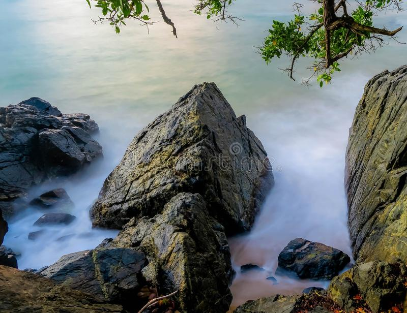 Waves crashing into rocky shore royalty free stock images