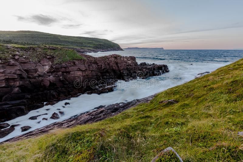 Waves crashing into the shore of Cape Spear, Newfoundland. Waves crash over the shores of Newfoundland on a regular basis. With its completely exposed shoreline stock image