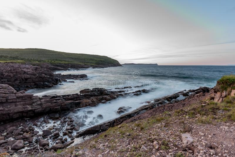 Waves crashing into the shore of Cape Spear, Newfoundland. Waves crash over the shores of Newfoundland on a regular basis. With its completely exposed shoreline royalty free stock photos