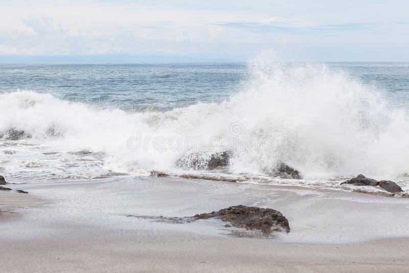 Waves crashing to rocks montezuma beach royalty free stock photos