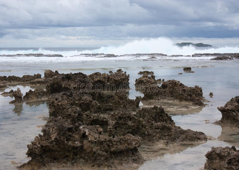 Waves crashing at a Tongan beach stock photos