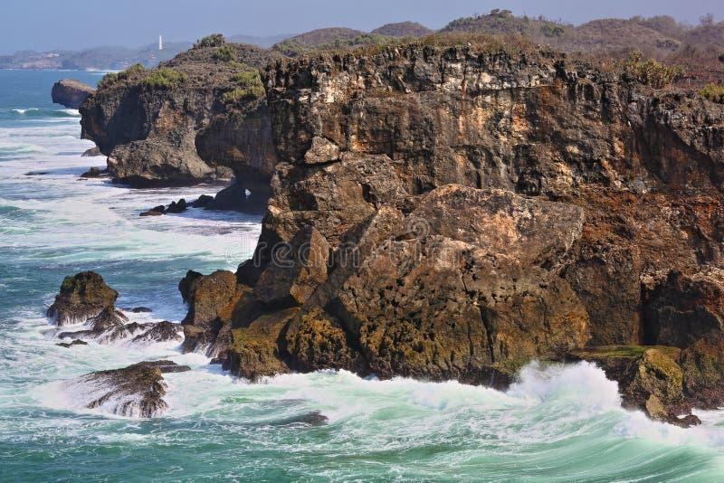 Waves Crashing on Yungyang Cliff Krakal Beach royalty free stock images