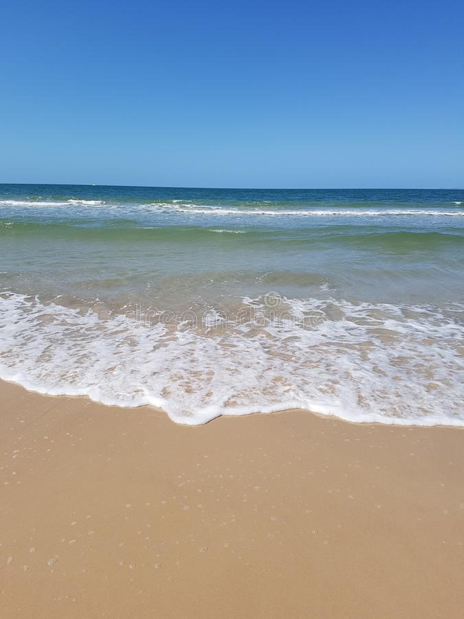 Beach froth on sand of bribie island royalty free stock images