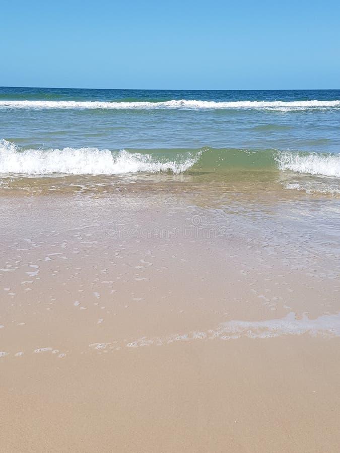 Waves on the beach of bribie island stock photo