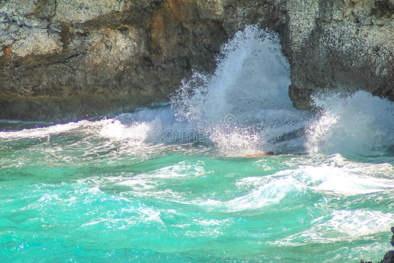 The waves hit hard on the reef and the sea water was moving fast royalty free stock images