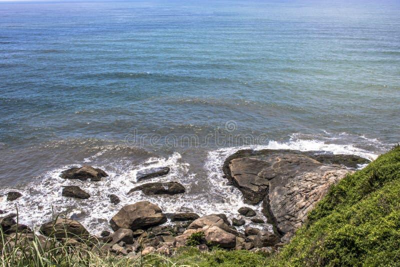 Waves hit the rocks stock photo
