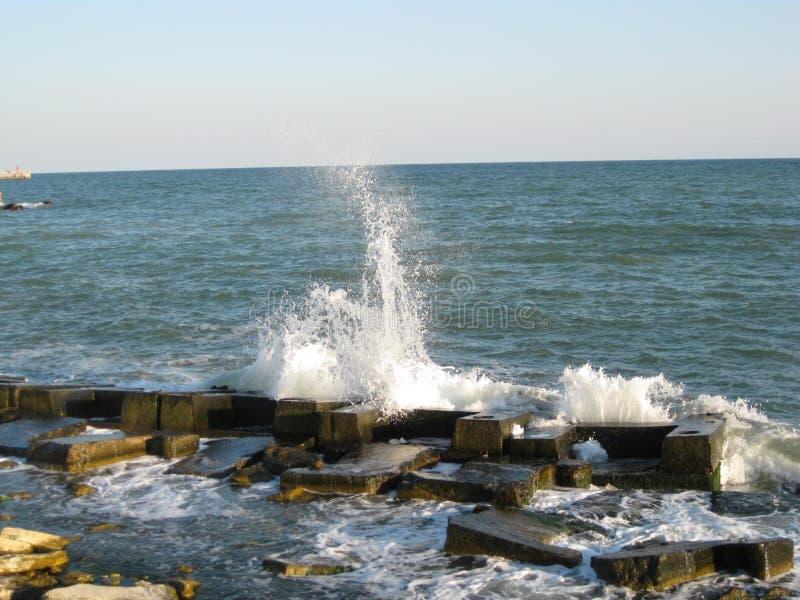 Waves hitting ashore stock photos