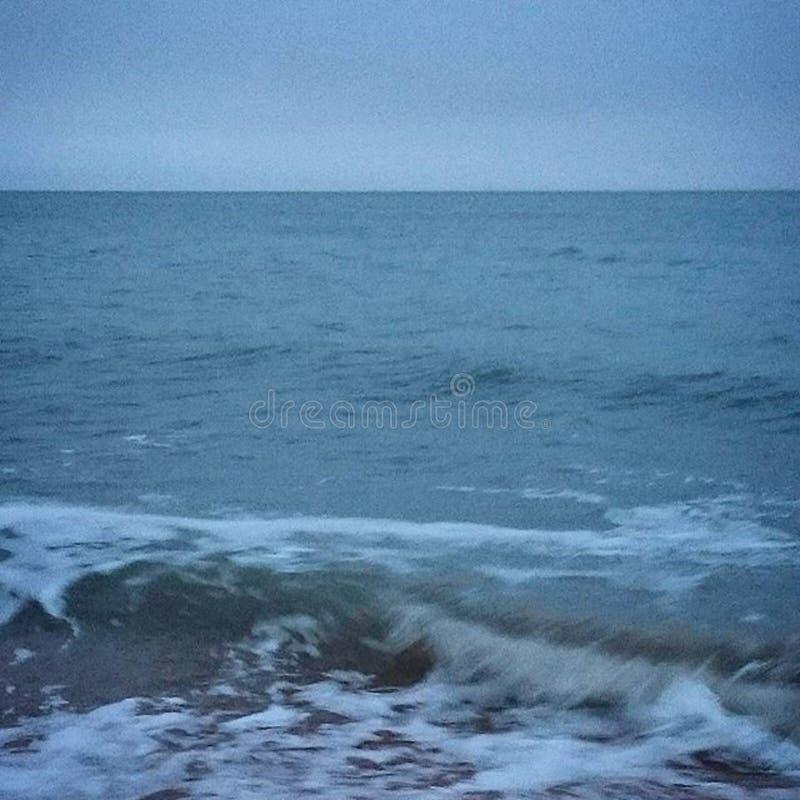 Waves hitting ashore royalty free stock photography