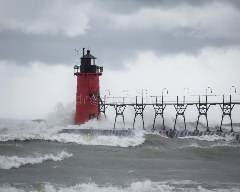 Waves hitting a pier light royalty free stock photos