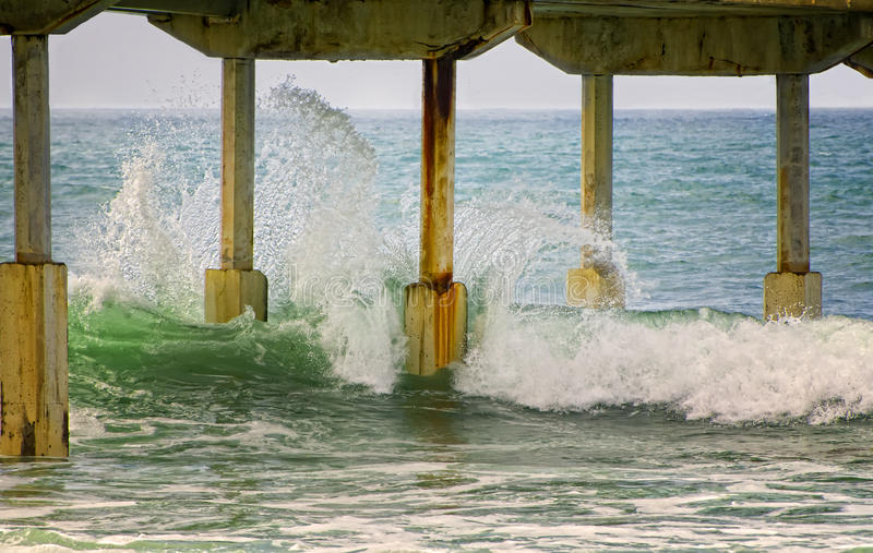 Waves Hitting Pier, San Diego California royalty free stock image