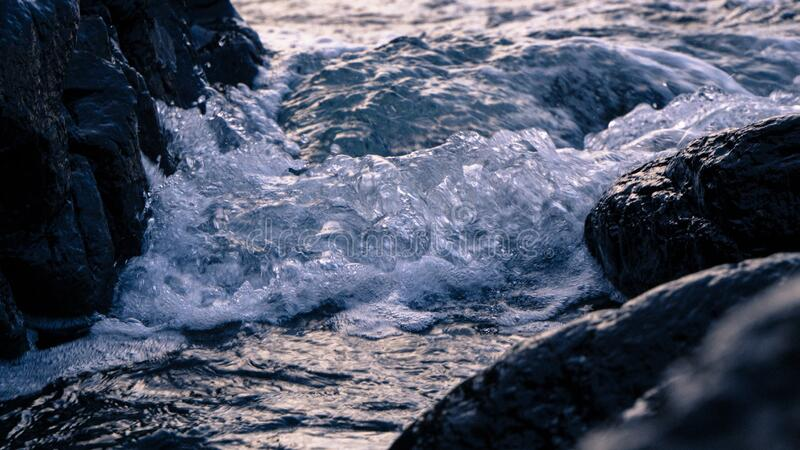 Waves hitting rocks stock photos