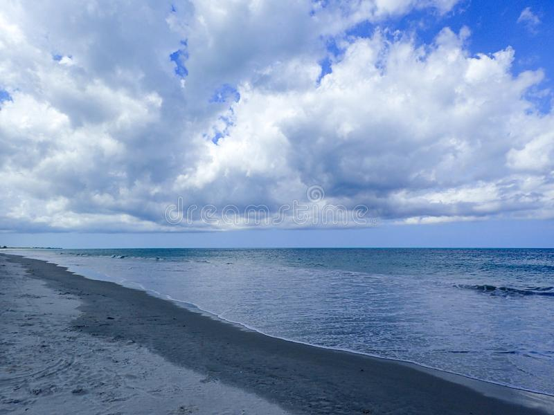 Waves lapping on the beach royalty free stock image