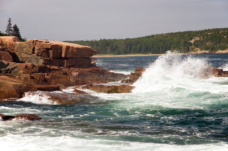 Waves on Maine coast. A view of a large ocean wave crashing on the rocks along the rocky Maine Coast. Arcadia National Park, Bar Harbor, Maine royalty free stock photos