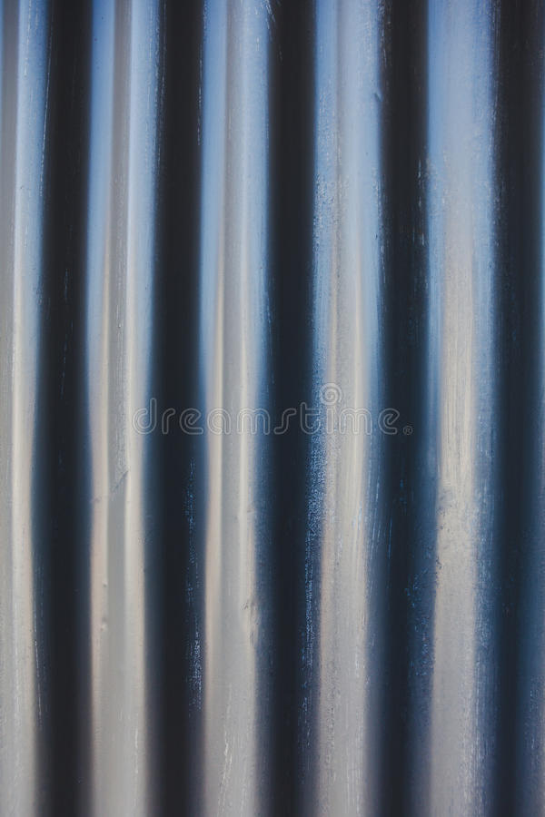 Waves metal sheets. Picture of wavy sheet of metal roof royalty free stock photos