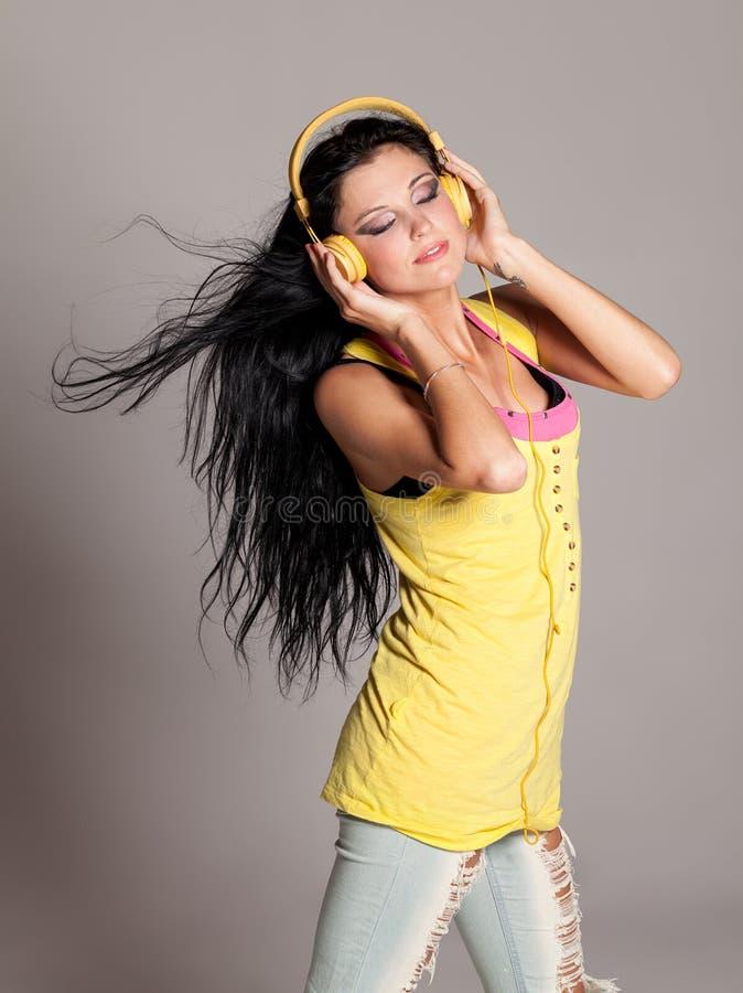 Waves of music. Girl enjoying music with eyes closed royalty free stock image