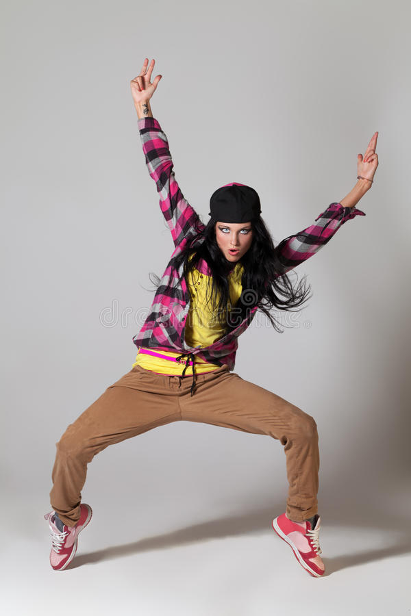 Waves of music. Young girl moving in the rhythm of hip-hop stock photos