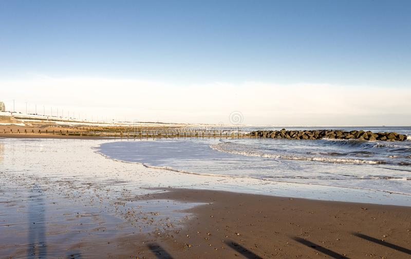 Waves of the North Sea enter the city beach in a nice sunny winter day, Aberdeen, Scotland royalty free stock images