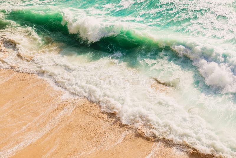 Waves in ocean. Beach break wave on sandy beach stock image