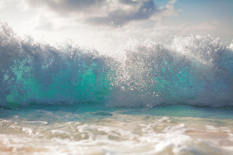 Waves in the ocean and sand on beach horizontal background stock photo