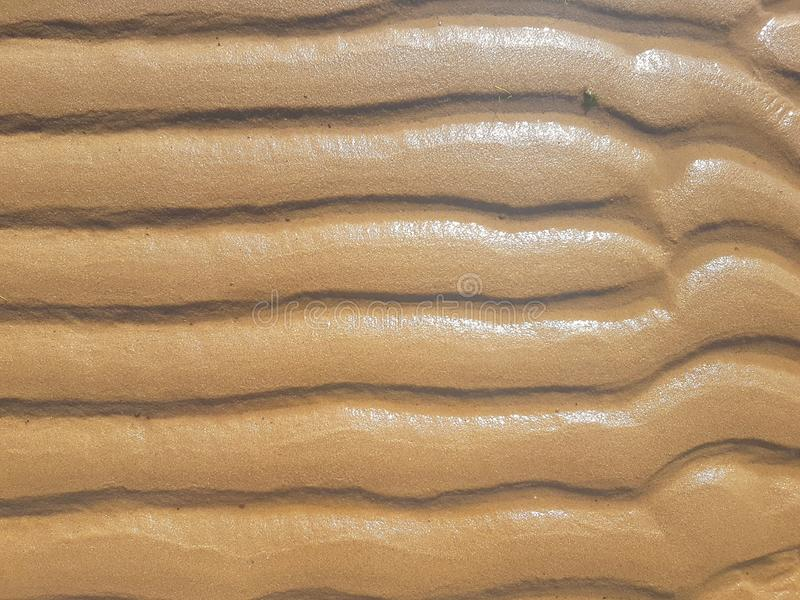 Waves over ground sand on river royalty free stock image