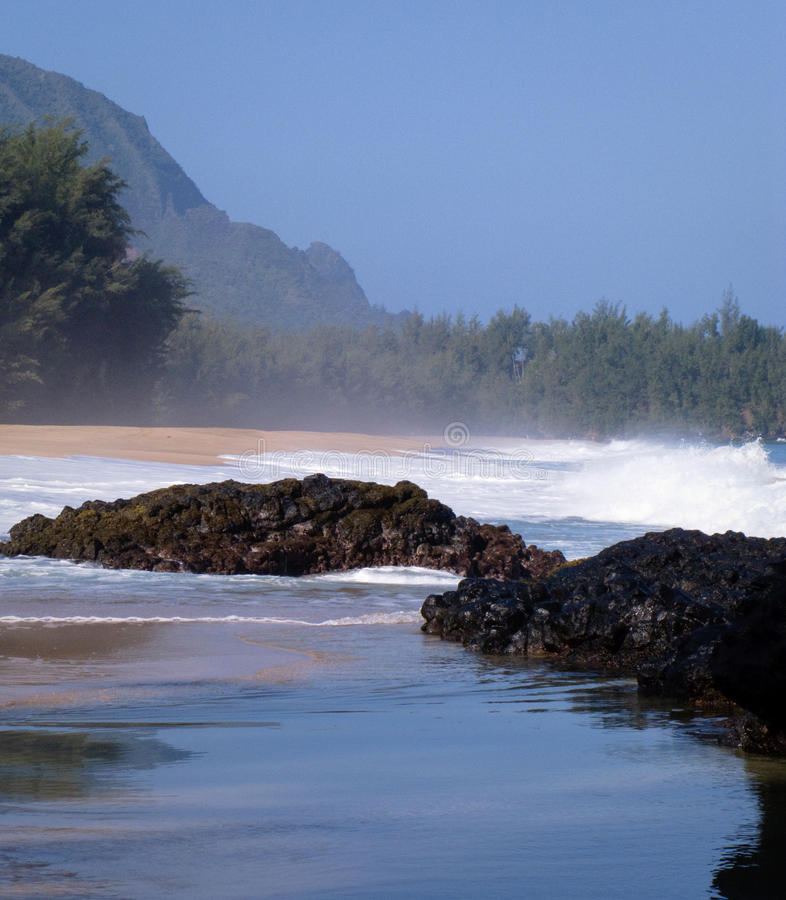 Download Waves Over Rocks On Lumahai Stock Image - Image of spray, ocean: 12849615