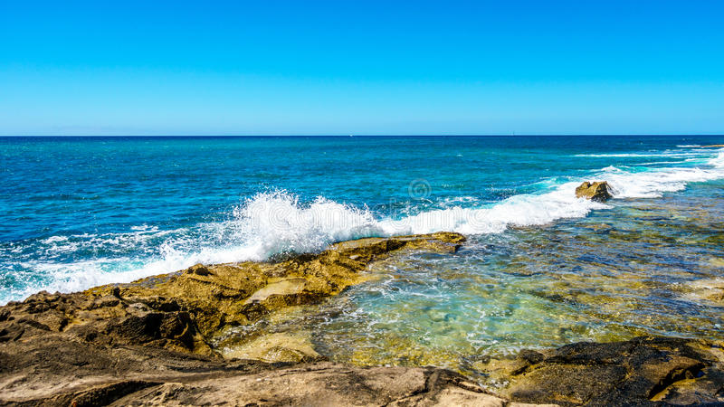 Waves of the Pacific Ocean crashing onto the rocky shoreline of the west coast of the island of Oahu stock photos