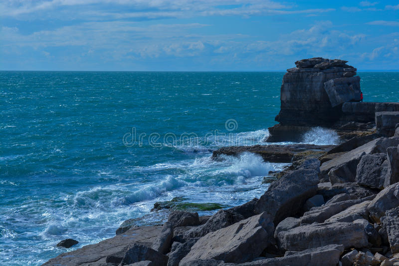 Waves & Rocks. This picture was taken at Portland Bill in Aug 2014 on a nice windy day near the lighthouse royalty free stock image