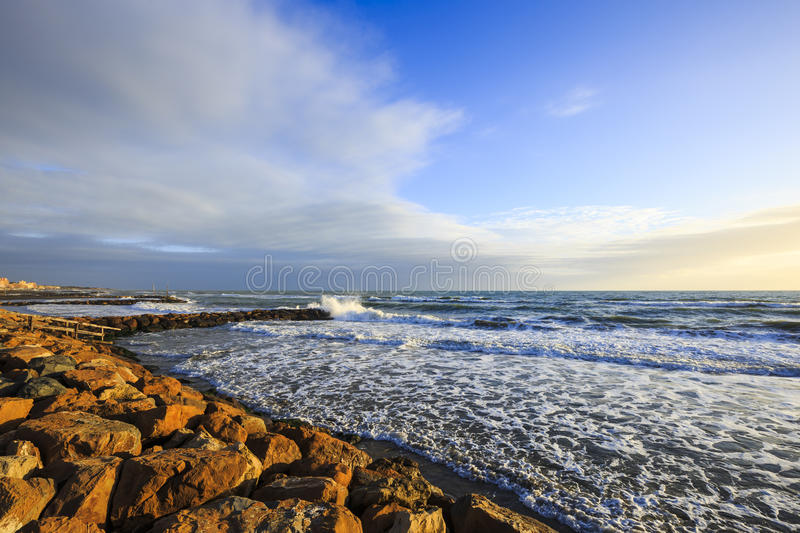 Waves on the rocks of the sea. Landscape in Ladispoli on the Tyrrhenian Sea in Italy stock photography