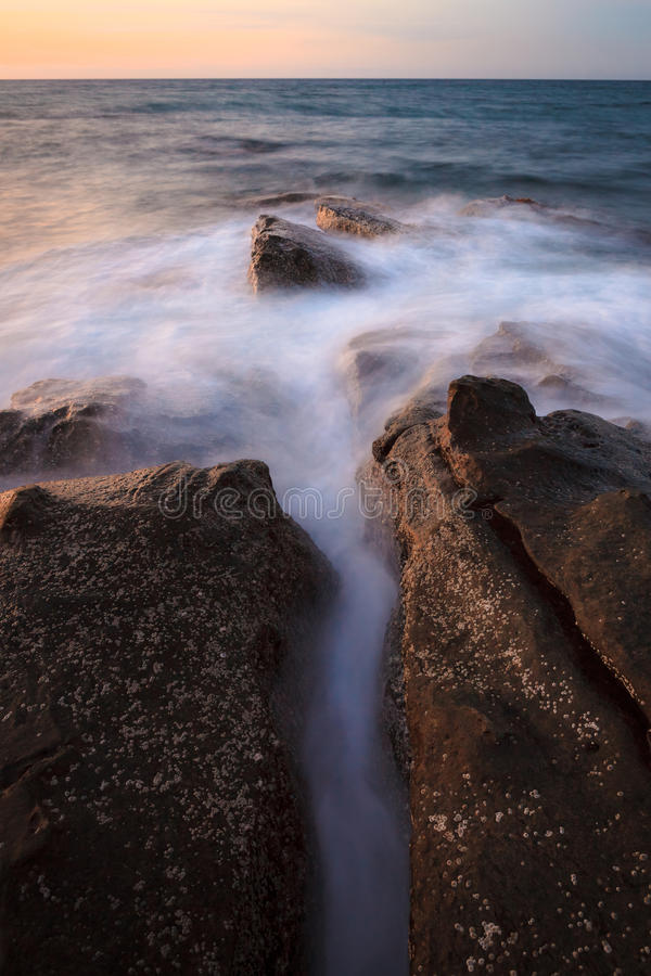 Waves and rocks shore long exposure royalty free stock photos