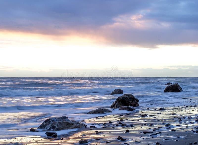 Waves on rocky beach stock photo