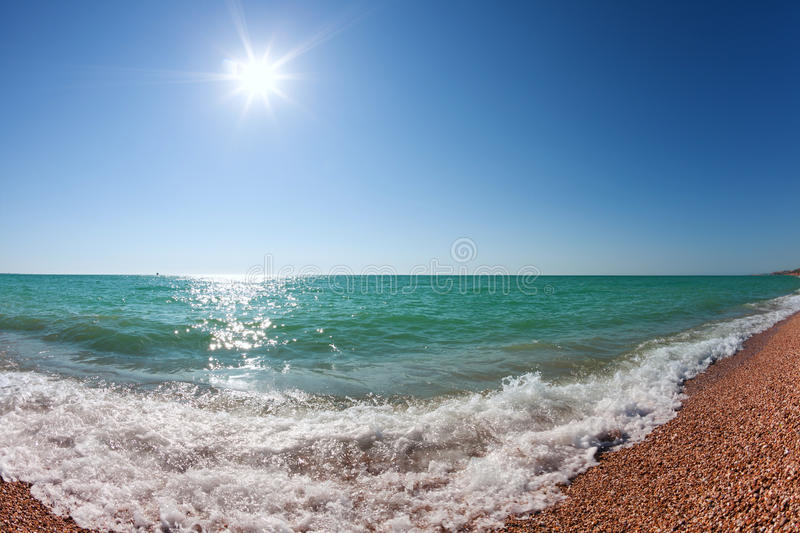 Download Waves Rolling To Shore Under A Sky With The Sun Stock Photo - Image: 26441942