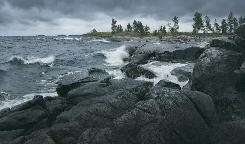 Waves of rough sea are breaking on rocky shore. Horizontal layout royalty free stock photos