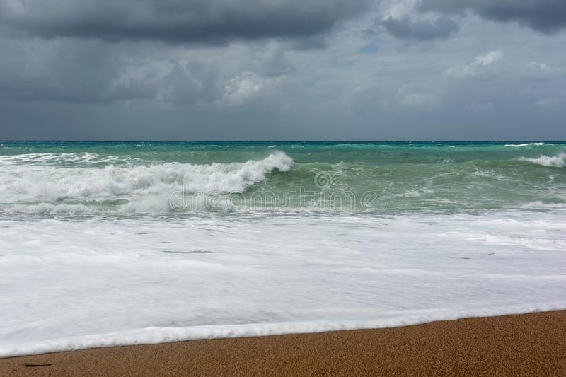 Waves On sand beach of the Aegean Sea in Rhodes stock photo