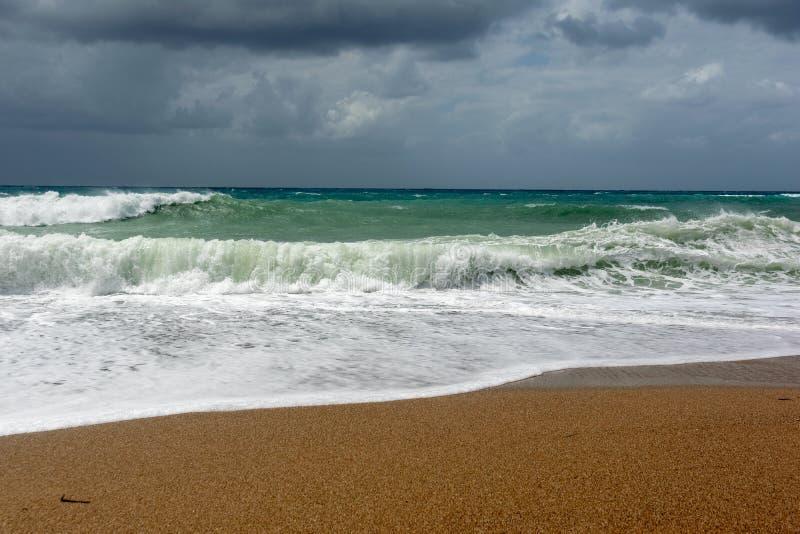 Waves On sand beach of the Aegean Sea in Rhodes stock photos