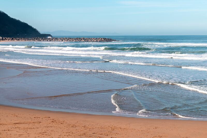 Waves in the sea in a sunny day in Donostia, San Sebastian, Spain. Waves in the sea in a sunny day in Donostia, San Sebastian royalty free stock photos