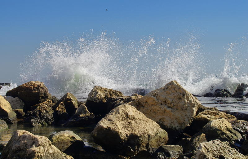 Seascape. Waves show. Summer, sea, sun, beach, rocks, holiday, fun and blue sky - Black Sea, landmark attraction in Romania royalty free stock images