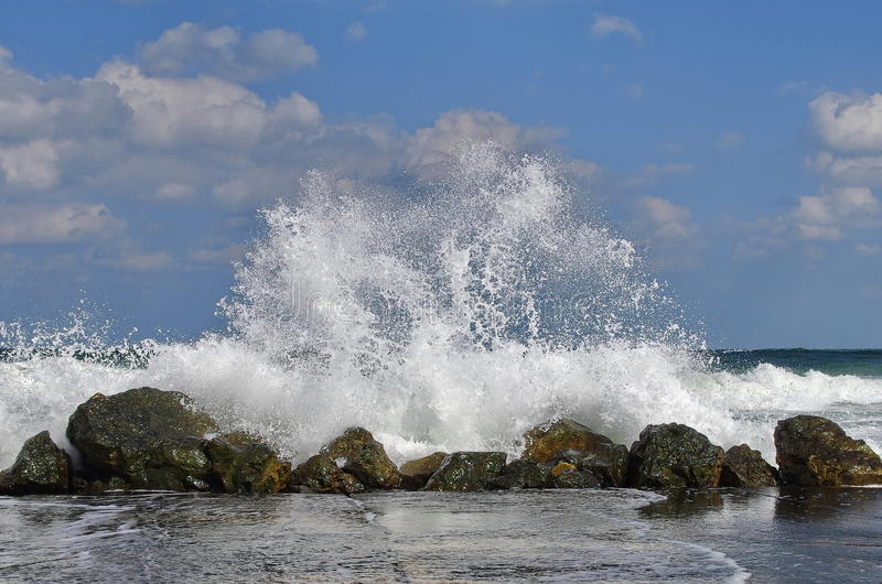 Seascape. Waves show. Summer, sea, sun, beach, rocks, holiday, fun and blue sky - Black Sea, landmark attraction in Romania royalty free stock photography