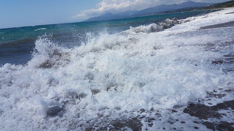 Waves splash foam in summer sea Preveza Greece. 4 royalty free stock photos