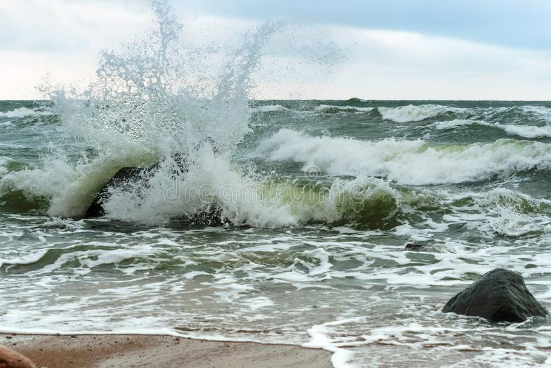 The waves splash on the shore, the waves beat against the rocks stock images
