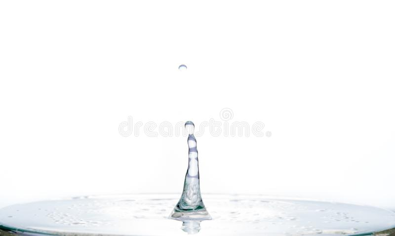 Waves and splash from water on the surface of the liquid on a white background royalty free stock photography