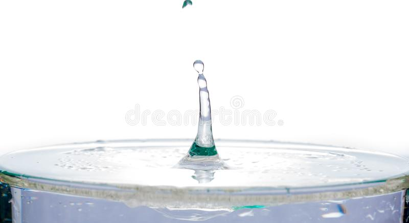 Waves and splash from water on the surface of the liquid on a white background stock photography