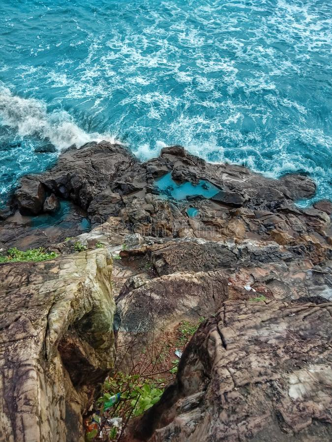 Waves splashing on the rocks. Rocks waves splashing beach bluewater stock photography