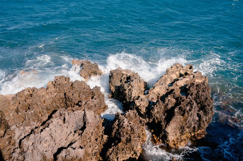 Waves splashing on the rocks meanwhile mistral is blowing royalty free stock images