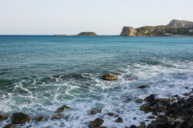 Waves On stone beach of the Aegean Sea in Rhodes stock photography