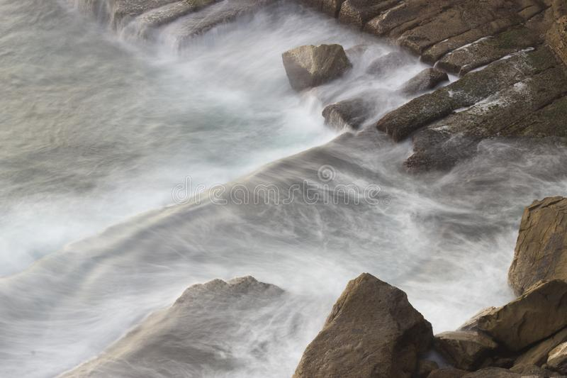 Waves on the stones royalty free stock images