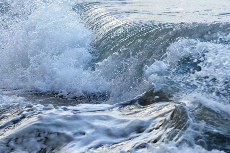 Waves in stormy ocean stock image