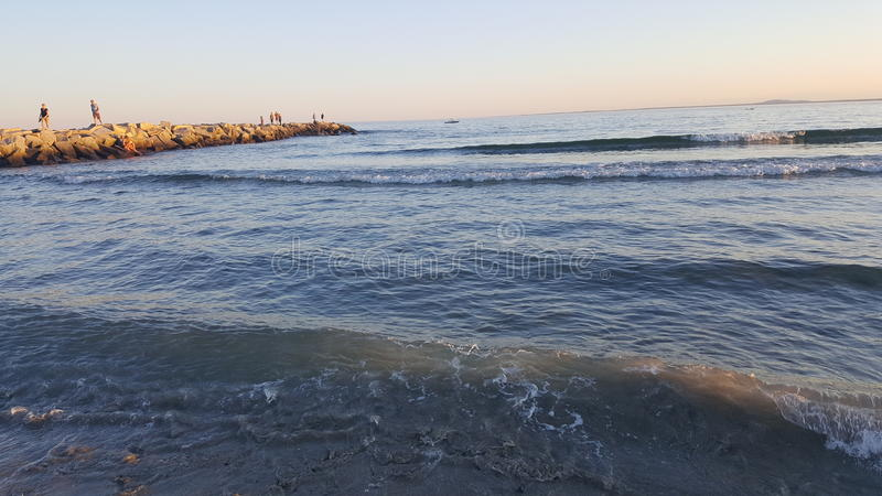 Waves at sunset royalty free stock photography